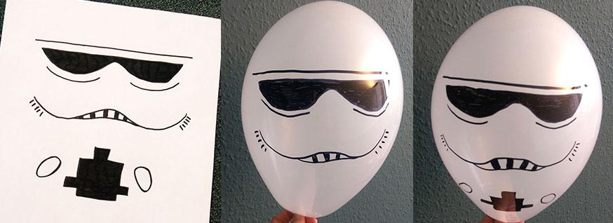Aus weißen Luftballons lassen sich eine coole Storm Tropper Deko basteln.
