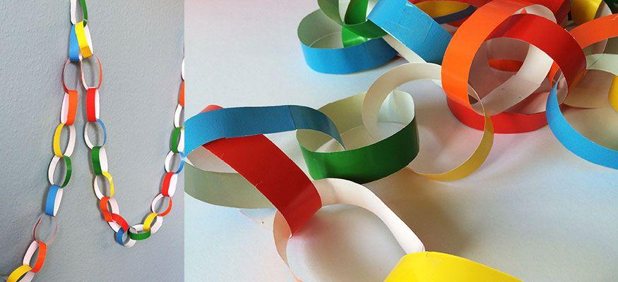 Mit ein paar bunten Papierstreifen basteln Sie im Nu eine Girlanden in Regenbogenfarben.